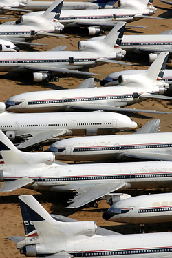 Photo of many planes stored side by side filling the frame