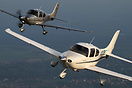 Cirrus SR20 N147CD and Cirrus SR22 GTS G3 Turbo D-EMRC in formation.