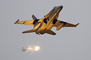 A RAAF demonstration team Hornet pops flares during its display at RAA...