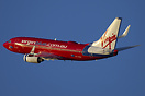 Cranking into the left turn from runway 15 a Virgin 737 departs on a t...