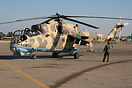 Mi-35 Hind 854 of 1335 Sqn being prepared for flight at Mitiga.
