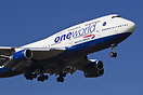 British Airways jumbojet with One World-stickers on short final for ru...
