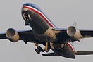 With her inlets full of moisture an American 772 departs Rwy 34L at To...