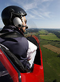 Windy rearseat view of the gyrocopter pilot of a MTO-Sport cruising ov...