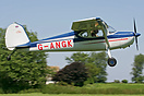 A British Cessna 140 leaving the famous grass strip on the Danish holi...