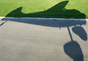 The shadow of a departing Cessna 195 seen from inside the aircraft