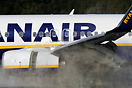 Ryanair Boeing 737 slowing down in reverse mode on a very wet runway