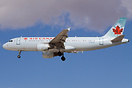 Air Canada seen landing at McCarran Airport with blue sky and some gre...