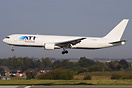 A new ATI Boeing 767-300 in revised colors seen shortly before landing...