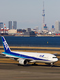 Taxiing in front of the Tokyo skyline with the prominent Sky Tree in b...