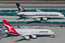 Qantas A380 VH-OQD together with Singapore Airlines Airbus A380 9V-SKD