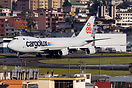 A Cargolux Boeing 747 freighter LX-YCV at Quito airport with a view of...