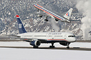US Airways N201UU taxiing by with American Airlines N624AA on departur...
