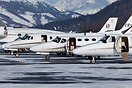 A mixed line up of Cessna Citations, sitting on a frozen ramp at Engad...