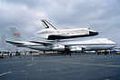 "Carrying space shuttle ""Enterprise"" on its back."