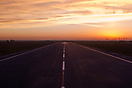 Taxiing on runway 16 while the sun is slowly rising above the horizon,...