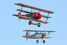 Formation of Simon Johnsons Isaacs Fury and Breightons Fokker DR1 G-BV...