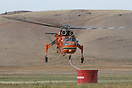 This Erickson Air-Crane Sikorsky S-64 is returning to re-fill its tank...