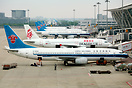 A typical ramp scene at Shanghai Pudong where several aircraft are bei...