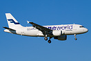 A Finnair A319 in Oneworld colors landing in Zurich