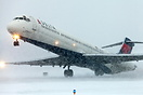 This MD88 departs into a major snow storm.