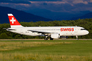 Swiss A320 with billboard titles departing from Geneva airport