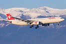 Swiss Airbus A330-300 landing in Geneva, seen in front of a winter bac...