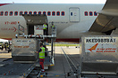 Unloading LD3 containers (ULD - unit load device) from an Air India Bo...