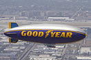 The Goodyear Airship N10A with Los Angeles Airport visible behind.