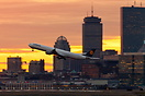 The Lufthansa Airbus A346 powers away from the City of Boston into a n...