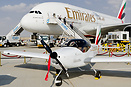 In front of the biggest aircraft in the fleet is the smalled in Emirat...