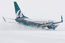 From a snow storm in Boston New Year's Eve 2009. AirTran is rolling ou...
