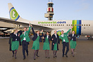 Transavia crew showing their new uniforms in front of their newly pain...