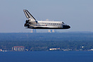 "Space shuttle orbiter ""Atlantis"" glides back to Earth. She is heading ..."