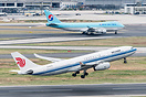 Taking off from runway 25C. In the background is Korean Air Cargo Boei...