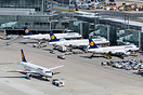 Terminal 1 A pier with several LH aircraft. Frames include A320 D-AIZG...