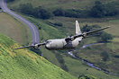 RAF Lockheed C-130J-30 Hercules C4 ZH879 on a low level sortie through...