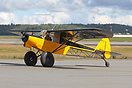 A heavily modified Piper Cub designed for short take off and landing.