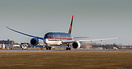 Battling heavy crosswinds, this Dreamliner rolls down the runway for t...
