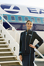 "Flight Attendant posing in front of the ""New Eastern"""