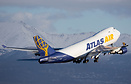 An Atlas 744F blasts off Rwy 15 at ANC giving a chance to photograph t...