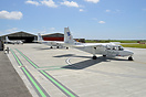 All three Skybus Britten-Norman Islander parked at the ramp at Lands E...