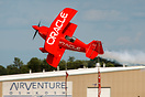Sean D. Tucker cuts the ribbon with his plane at the Airventure air sh...
