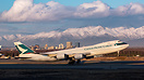 With the sun setting a Cathay Cargo 748F rotates out of Anchorage from...