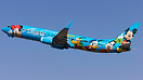 The Alaskan Disney special scheme 737 departs Anchorage for Seattle on...