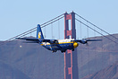 The Blue Angels C-130 Hercules performing over Golden Gate Bridge in S...