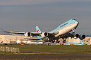Korean Air's 747-8 Intercontinental rotates and climbs up on her deliv...