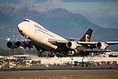 A UPS 744F departs Anchorage from runway 33 in the last evening sun.