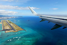 "Overview of the ""Reef Runway"" on climb out from Honolulu."