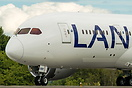 Close up nose shot of the LAN Airlines 787-8 dreamliner taking off run...